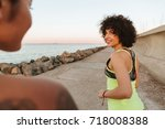 cropped picture of two fitness... | Shutterstock . vector #718008388