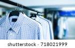 rack of clean clothes hanging... | Shutterstock . vector #718021999