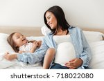 happy smiling pregnant asian... | Shutterstock . vector #718022080