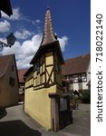 Small photo of Half-timbered house on a narrow street in Eguisheim, Alsace, France