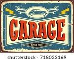 vintage garage sign with car... | Shutterstock .eps vector #718023169