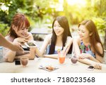 young woman paying bill with... | Shutterstock . vector #718023568