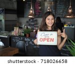 asian woman with. open sign in... | Shutterstock . vector #718026658