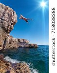 jump from the cliff in croatia  ... | Shutterstock . vector #718038388