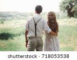 happy bride and groom in a... | Shutterstock . vector #718053538