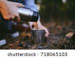traveler girl pouring tea from... | Shutterstock . vector #718065103