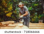 Man Cutting Piece Of Wood With...