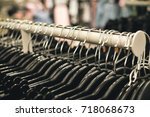 fashion clothing hanging on... | Shutterstock . vector #718068673