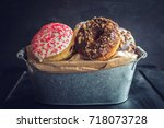 sweet glazed donuts in the... | Shutterstock . vector #718073728