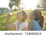 two female friends outdoors in... | Shutterstock . vector #718085014
