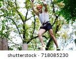 man steps on the wooden blocks... | Shutterstock . vector #718085230
