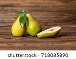 pears fruits on old wooden... | Shutterstock . vector #718085890