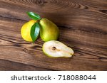 pears fruits on old wooden... | Shutterstock . vector #718088044