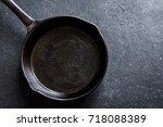 cast iron pan on rustic black...   Shutterstock . vector #718088389