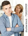 mother arguing with teenage son | Shutterstock . vector #718105909