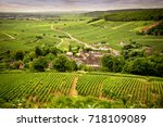 hills covered with vineyards in ... | Shutterstock . vector #718109089