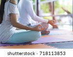 young couple people doing yoga... | Shutterstock . vector #718113853
