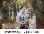 family with a small child in... | Shutterstock . vector #718114108