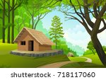 a small village in the middle... | Shutterstock .eps vector #718117060