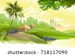 a beautiful village next to a... | Shutterstock .eps vector #718117090