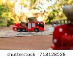 miniature red fire truck carry... | Shutterstock . vector #718128538