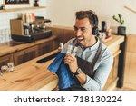 worker in headphones pretending ... | Shutterstock . vector #718130224