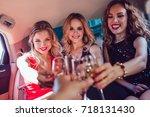 pretty women having party in a... | Shutterstock . vector #718131430