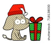 cartoon unsure elephant sat on... | Shutterstock .eps vector #718138030