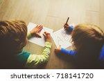kids write letters  do homework | Shutterstock . vector #718141720