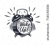 wake up  inscription on alarm... | Shutterstock .eps vector #718150330