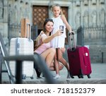 cheerful mother with little... | Shutterstock . vector #718152379