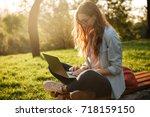 side view of pleased brunette...   Shutterstock . vector #718159150