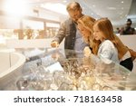 family in shopping mall looking ... | Shutterstock . vector #718163458