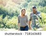 happy mature couple walking in... | Shutterstock . vector #718163683