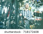 young cyclist decide on... | Shutterstock . vector #718172608