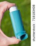 blue asthma inhaler | Shutterstock . vector #718183408