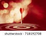 target hit in the center by... | Shutterstock . vector #718192708