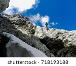 Small photo of Man on an abrupt cliff of the french alps.