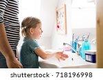 little girl in bathroom with...   Shutterstock . vector #718196998