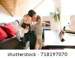 young family with tablet... | Shutterstock . vector #718197070
