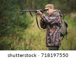 hunter with a backpack and a... | Shutterstock . vector #718197550