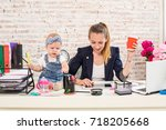 mom and businesswoman working... | Shutterstock . vector #718205668