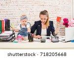 mom and businesswoman working... | Shutterstock . vector #718205668