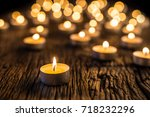 christmas candles burning at...   Shutterstock . vector #718232296