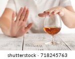 woman refuses to drink a alcohol | Shutterstock . vector #718245763