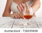 Small photo of woman refuses to drink a alcohol