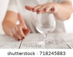 woman refuses to drink a alcohol   Shutterstock . vector #718245883