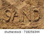 inscription on the sand   Shutterstock . vector #718256344