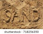inscription on the sand   Shutterstock . vector #718256350