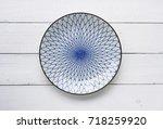 ceramic dish  plate  on wooden...   Shutterstock . vector #718259920
